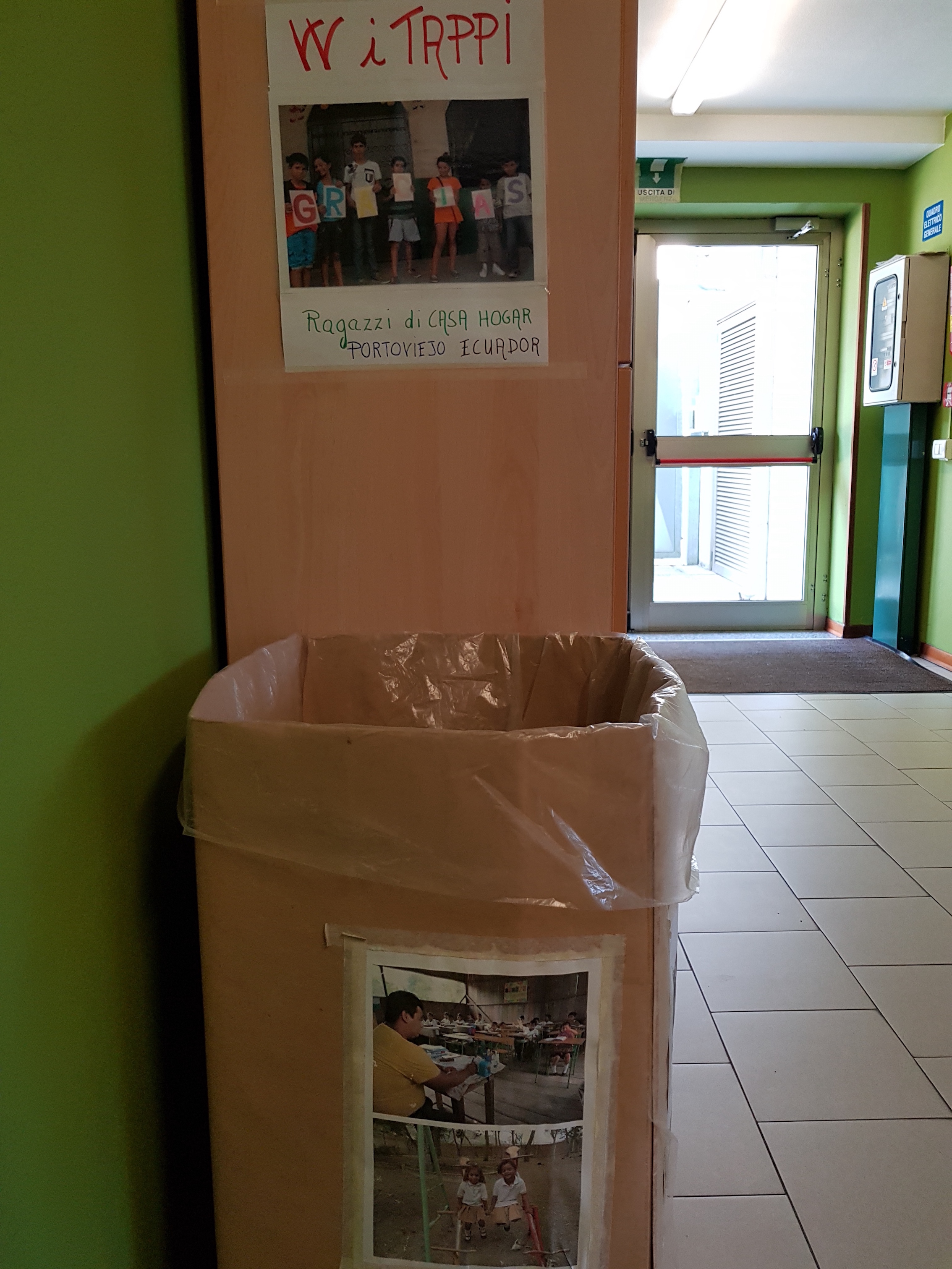 The picture shows the initiative of a group of volunteers aimed to collect caps of bottles in the public library to send funds to the poor countries of the world.